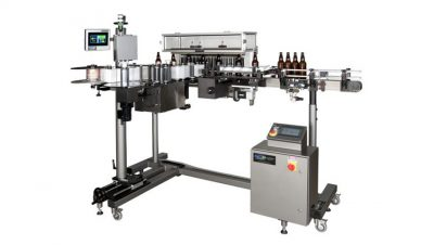 Automatic Bottle Labeling Machine–Vertical Trunnion Roller--loaded with beer bottles.