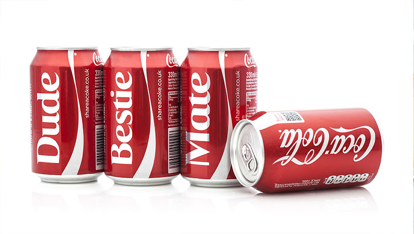 """Four Coca Cola Classic cans displaying personalized labels that read """"Dude, Bestie, and Mate."""""""